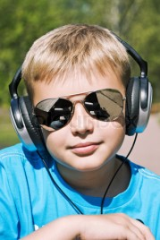 Boy listening to music through headphones