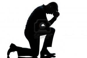 Man Kneeling in Prayer