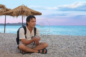 Young man resting on the beach