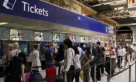 Rail travellers queue-