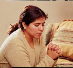 Woman Kneeling in Prayer