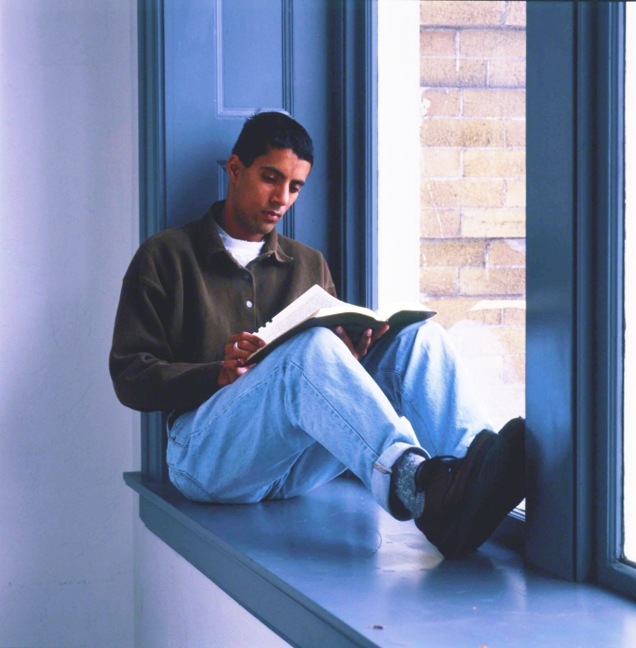 Young Man Reading Scripttures